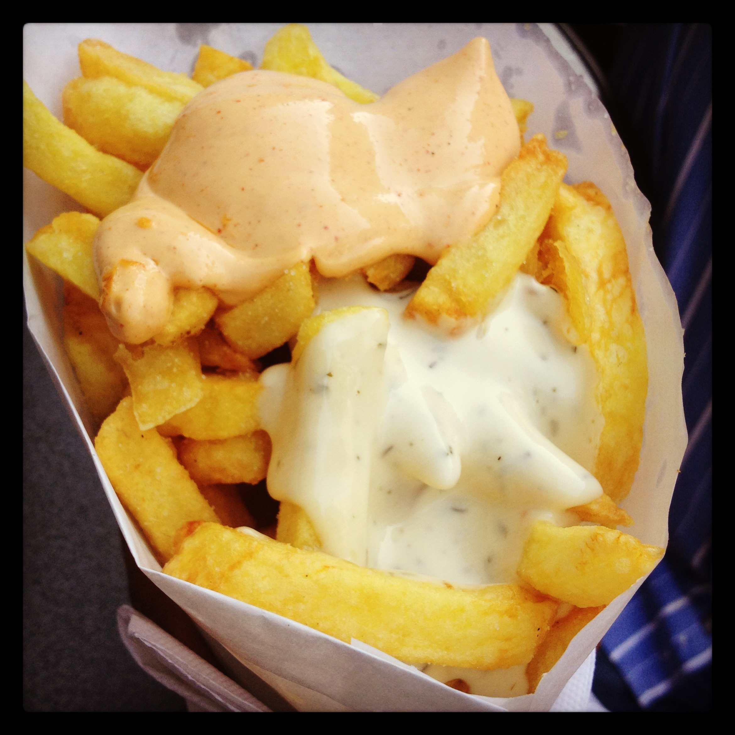 Belgian fries topped with Piri Piri Sauce and Garlic Mayo