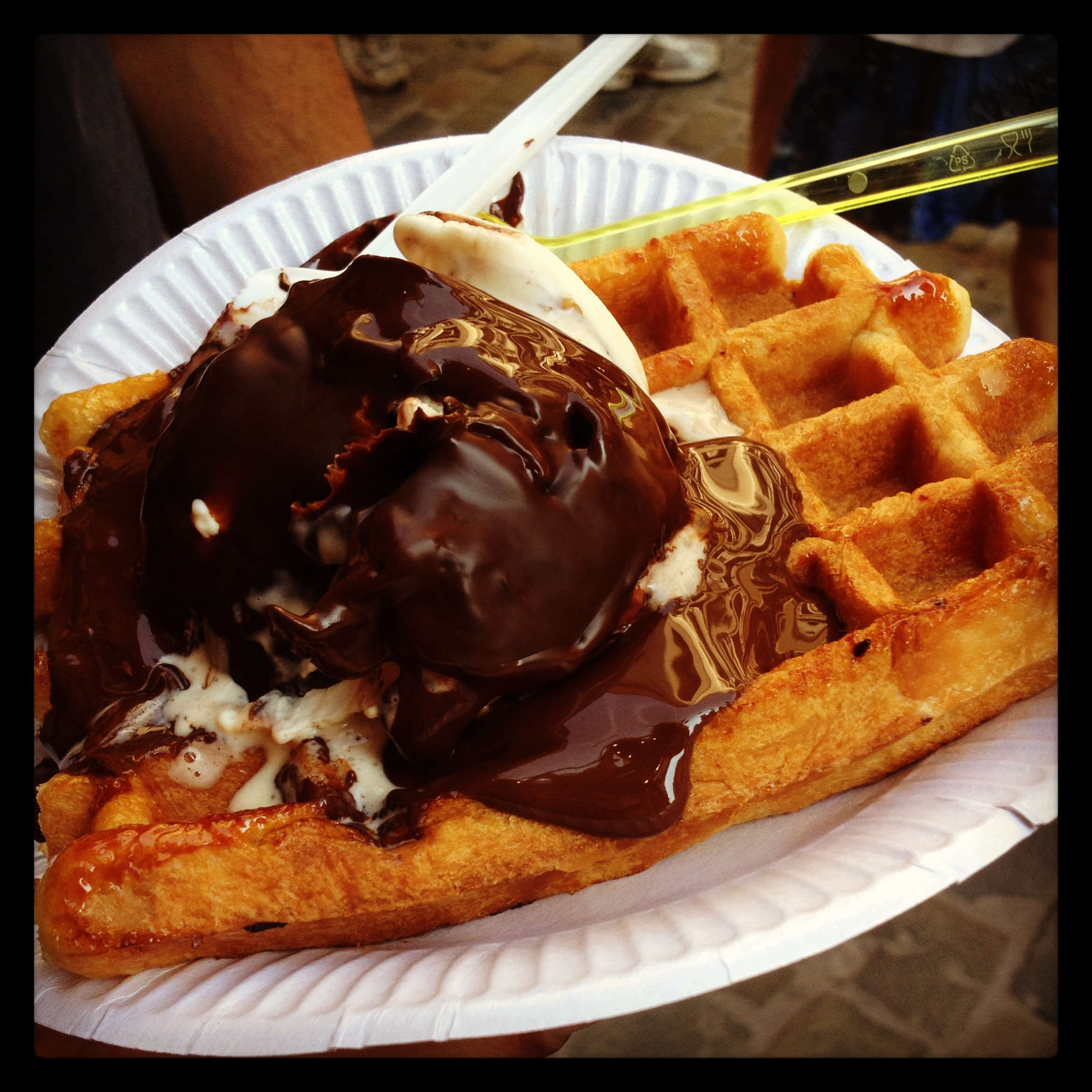 Belgian Waffle topped with ice cream and chocolate sauce